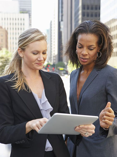 community services division image of two women looking at an ipad