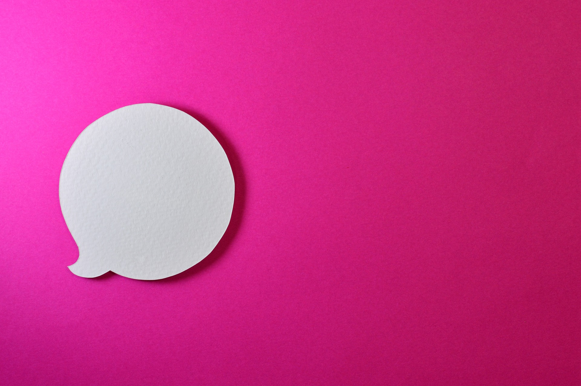 a conversation bubble on a pink background