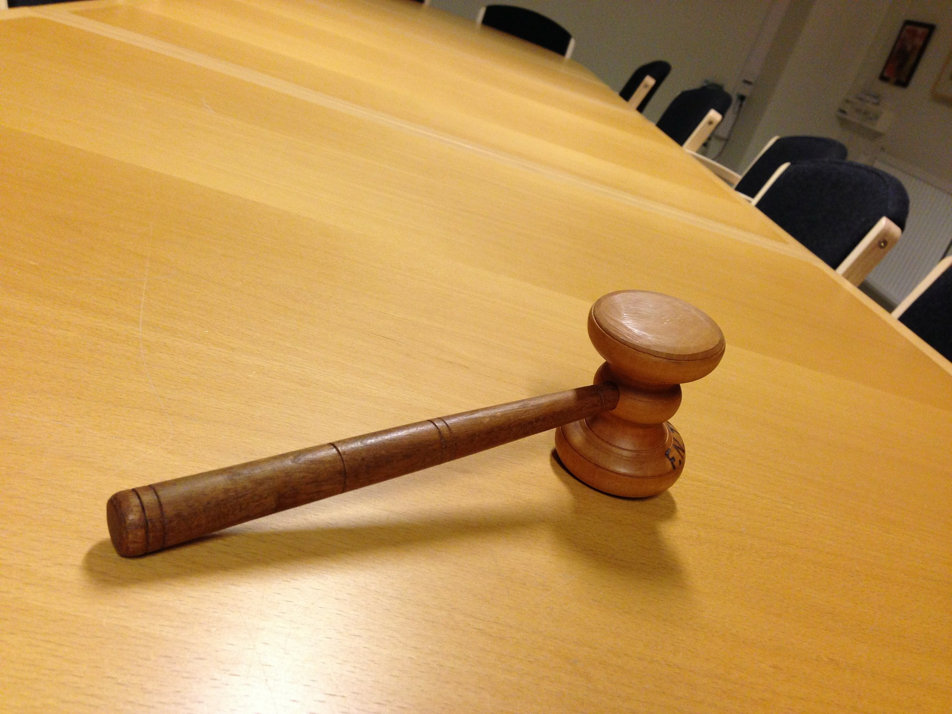 a meeting table with a gavel on it
