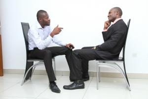 Two men talking while seated