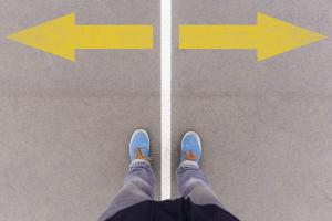 a person standing over a line with two arrows pointing in opposite directions
